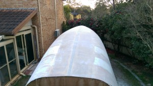 The Didi 40 Cr hull glassed and sanded with some fairing in progress