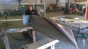We used a long RHS welded to the surplus plate at the front to get leverage to wrap the plate around the tight curve.
