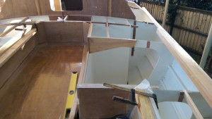 Plywood reinforcement has been added to the frames at the ends of the deck locker hatch.