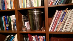 Three Sail Port Stephens buckets in four regattas neatly stacked in the bookcase.