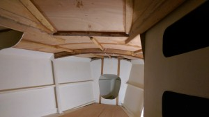 The sloping cabin front is where one hatch will go. There is still some deck to lay at the front of the V berth. The bare timber patches are where the hull was supported on the building frame when it was upside down.