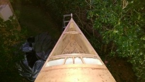The stem head fitting from the anchor locker side showing the laminated beams front and back of the anchor locker hatch.