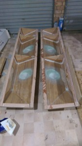 Glass reinforcement under the winch bases. One is finished the other still has a few layers to go
