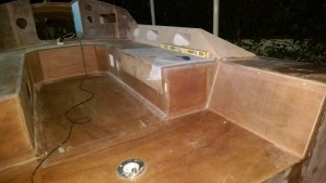 The glue in the cockpit locker lid is curing while the lid is secured in situ.
