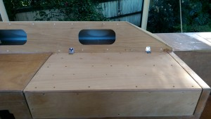 The hinged locker lid almost ready for glassing. Note the thickness of the aft edge of the locker.