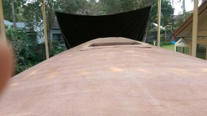 Trial fit of the first cabin top hatch surround on our Didi 40 Cr showing the sloping edges.