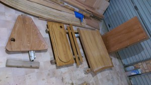 Hatch covers lined up in the garage. All latches trial fitted and both sides glassed or saturated with epoxy