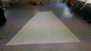 The top panel of the mainsail showing the modest fat head.