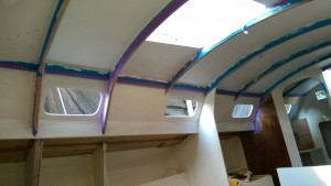 Cabin sides with one coat of primer and ceiling with two