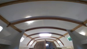 The ceiling and cabin sides are painted ready for varnishing the laminated beams.