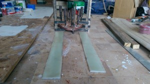 Epoxy glass wedges ready to be cut and drilled for stanchion packers and a plywood spacer for under the mast step