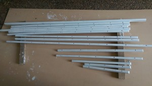 Lots of toe rail cut and drilled ready for more coats of paint.