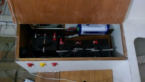 The battery box, isolation switches, charge control relay and battery charger.