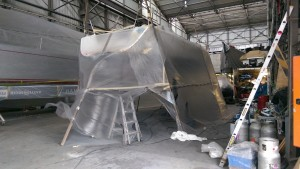 Plastic shrouding around Passion X to stop the overspray going on Wild Oats XI