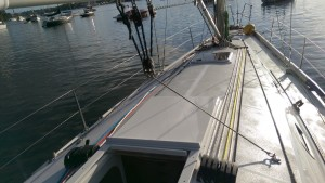 Cabin top hand hold and jack lines as well as conventional webbing deck level jack lines. Also a good view of the mainsheet bridle system and the narrow deck that needed the smaller diameter deck organizers.