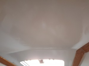 A close up of the clean lines of the 24 mm thick moulded ply V berth ceiling