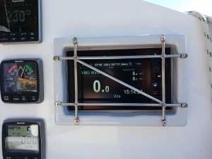 A protective cage for the chartplotter. It is removable so that the sun cover can be replaced after each outing.