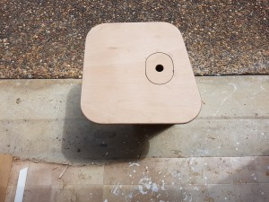 The coffee table sized lid for the table support with the small hatch for storing the four bottles of wind