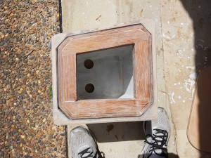 The eight sided inner box sliding inside the four sided outer box. The two holes in the inner box floor are to clear the keel bolt nuts