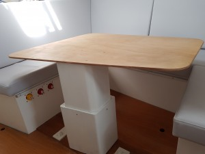 A view of the base supporting the table in the up position