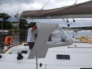 Shane Beashel fitting the new spray dodger at Newport