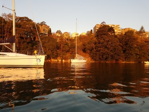 After the race just before sunset with a great reflection of the yacht and background on the water